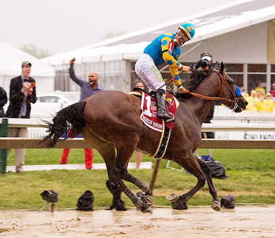 American Pharoah looks ahead while jock Victor Espinoza wants to looking back after the finish