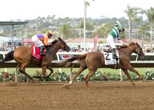 Hronis Racing's Stellar Wind and jockey Victor Espinoza, right, overpower Beholder (Gary Stevens), left, to win the Grade I, $300,000 Clement L. Hirsch Stakes, Saturday, July 30, 2016 at Del Mar Thoroughbred Club, Del Mar CA. © BENOIT PHOTO
